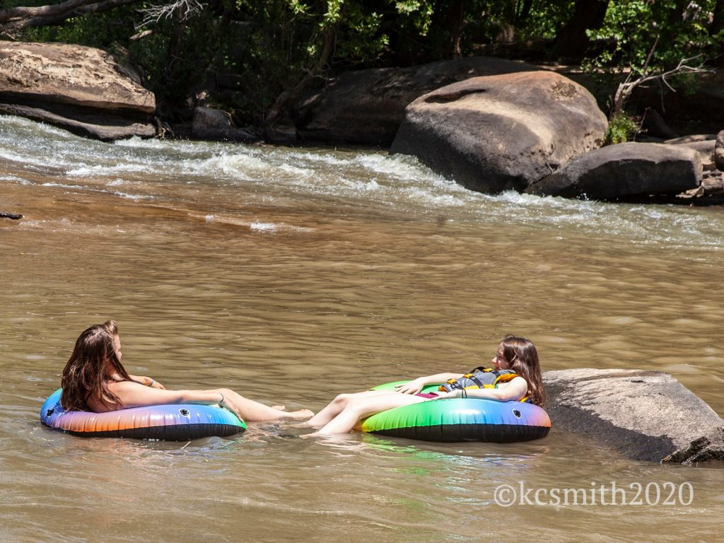 Girls flost and relax in the water at RiverPark in Cooleemee, NC